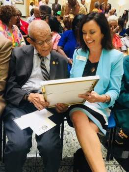 Mr. Lloyd Pearson and Beaches Museum Director Chris Hoffman admire a plaque honoring Rutledge Pearson at post office renaming ceremony on July 20, 2018.