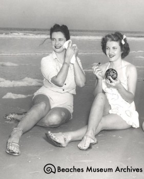 Phyllis Webb (left) and Jean McCormick (right) on the beach, photo by Virgil Deane (1948)