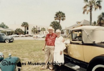 "J. T. & Mrs. McCormick Attending ""Saturday in the Park"" during Centennial Celebration, museum in background (1984)"