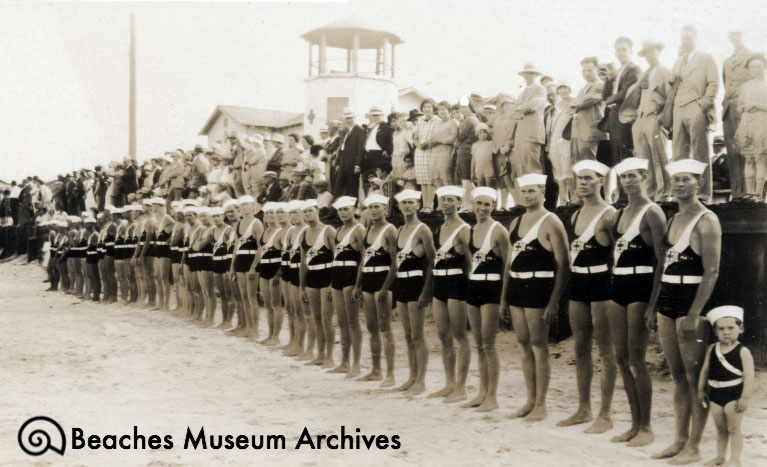 Lifeguards demonstrating drills to spectators in front of Station #1 in Jacksonville Beach in the 1920s.