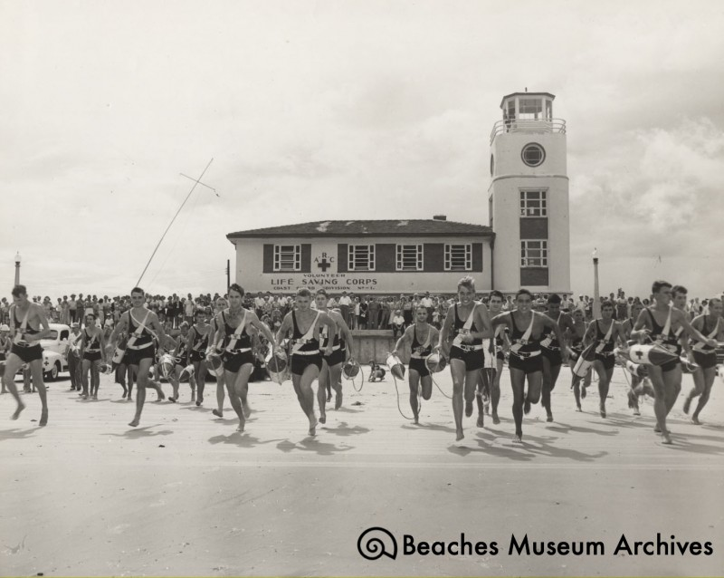 Local lifeguards participating in the annual Meninak Ocean Marathon Swim around 1948 at the newly constructed third incarnation of Station #1. Photo by Virgil Deane.