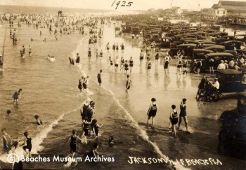 This photo shows the Jacksonville Beach beachfront filled with crowds of bathers and cars in 1925.
